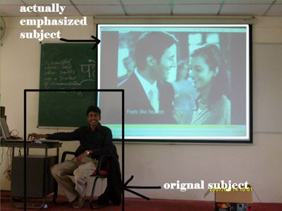 Classroom, student in front of projected screen: by Ashveen